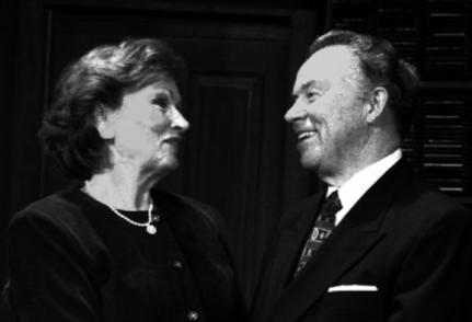 woman and man talking together, laughing