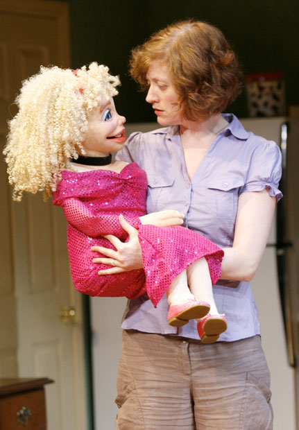 woman holding a dummy puppet